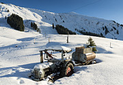 Snow-covered Landscape Prints - Old tractor in winter with lots of snow waiting for spring Print by Matthias Hauser