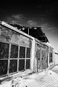 Sask Prints - old traditional brick and wood building in disrepair Forget Print by Joe Fox