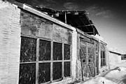 Sask Prints - old traditional brick and wood building in disrepair Forget Saskatchewan Print by Joe Fox