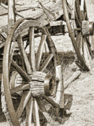 Old Wagon Prints - Old Wagon Wheels in Sepia Print by Jennie Marie Schell