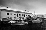 Warehouses Framed Prints - old warehouses and small fishing boats Honningsvag harbour finnmark norway europe Framed Print by Joe Fox