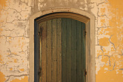 Entrance Door Framed Prints - Old Wooden door with cracks on the wall Framed Print by Kiril Stanchev