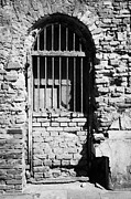 Old Jewish Area Photos - Old Wooden Framed Window With Weathered Steel Bars Door Replacement In Red Brick Building With Plaster Removed Krakow by Joe Fox