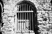 Old Jewish Area Photos - Old Wooden Framed Window With Weathered Steel Bars In Red Brick Building With Plaster Removed Krakow by Joe Fox