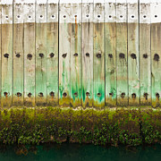 Weatherworn Prints - Old wooden pier wall with tidal waterline Print by Stephan Pietzko
