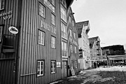 Warehouses Framed Prints - old wooden warehouses on Tromso bryggen troms Norway europe Framed Print by Joe Fox