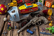 Playthings Photo Prints - Older roller skate and toys Print by Garry Gay