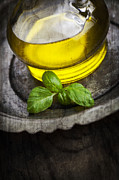 Healthy Herbs Posters - Olive oil and basil Poster by Mythja  Photography