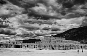 Conquistadores Framed Prints - Ominous Clouds over Taos Pueblo Framed Print by Silvio Ligutti