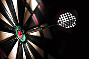 Board Game Photos - One arrow in the centre of a dart board by Michal Bednarek