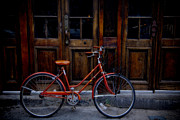 City Streets Photos - Orange Bike by Garry Gay