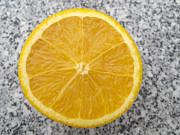 Orange Cut In Half Grey Background Print by Matthias Hauser