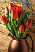 Pitchers Photos - Orange tulips in copper pitcher by Garry Gay