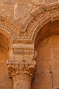Ruin Photo Prints - Ornate details of sculpted pillars at Rasafa Syria Print by Robert Preston