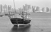 Wooden Ship Prints - Ornate dhow and Doha towers Print by Paul Cowan