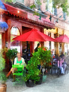 Street Scene Framed Prints - Outdoor Cafe With Red Umbrellas Framed Print by Susan Savad