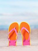 Oleksiy Maksymenko Framed Prints - Pair of bright orange flip flops at the beach Framed Print by Oleksiy Maksymenko