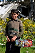 Yellow Sweater Posters - Pakistani boy in front of hotel ruins in Swat Valley Poster by Imran Ahmed