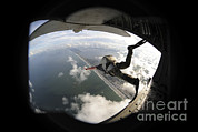 Us Open Framed Prints - Pararescuemen Jumps From An Hc-130pn Framed Print by Stocktrek Images