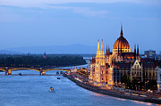 Blue Danube Posters - Parliament Building in Budapest at Evening Poster by Artur Bogacki