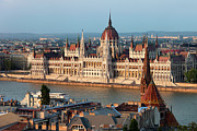 Rooftop Prints - Parliament Building in Budapest at Sunset Print by Artur Bogacki