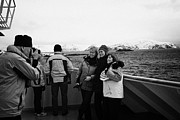 Winter Photos Prints - Passenger Taking Photos Of Tourists On Board Hurtigruten Passenger Ship Sailing Through Fjords  Print by Joe Fox