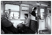 Young Man Prints - Passengers - Budapest train - Hungary Print by Madeline Ellis