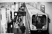 Bahn Prints - passengers on ubahn train platform as train leaves Friedrichstrasse u-bahn station Berlin Germany Print by Joe Fox