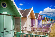 Painted Wood Prints - Pastel Beach Huts 3 Print by Chris Thaxter