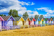 Painted Wood Prints - Pastel Beach Huts Print by Chris Thaxter