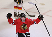 Skating Posters - Patrick Kane celebrating a goal Poster by Sanely Great