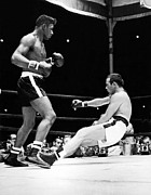 Famous Boxer Framed Prints - Patterson Knocks Out Johansson Framed Print by Underwood Archives