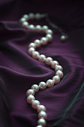 String Of Pearls Posters - Pearl Necklace On Purple Silk Poster by Lee Avison