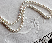 Old Jewelry Framed Prints - Pearls and Old Linen Framed Print by Barbara Griffin