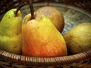 Food And Beverage Photos - Pears in a basket by Elena Elisseeva