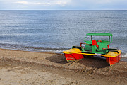 Kyrgyzstan Photos - Pedalo on the shore of Lake Issyk Kul in Kyrgyzstan by Robert Preston