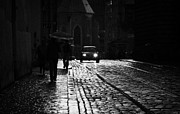 Old Krakow Framed Prints - Pedestrians With Umbrellas Car Driving Along Wet Cobblestoned Tram Lines In The Road In The Old Town Krakow Framed Print by Joe Fox