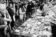 Local Food Prints - people buying chocolates on display inside the la boqueria market in Barcelona Catalonia Spain Print by Joe Fox