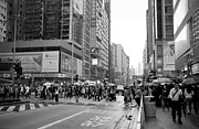 Rainy Day Photos - People crossing the street on a rainy day in Mong Kok Hong Kong by Ivy Ho