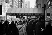 5th Ave Prints - People On The Sidewalk Beneath The Entrance To The Empire State Building On Fifth Avenue New York Print by Joe Fox