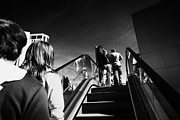 Escalator Prints - people riding on escalators on Las Vegas boulevard Nevada USA Print by Joe Fox