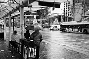 Busstop Prints - people standing in the rain waiting for a bus on burrard street downtown Vancouver BC Canada Print by Joe Fox