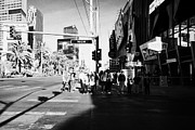 Crosswalk Prints - people waiting to cross at intersection on south Las Vegas boulevard strip Nevada USA Print by Joe Fox