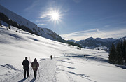 Winter Landscape Photos - People walking in beautiful sunny winter landscape in the alps with lots of snow by Matthias Hauser