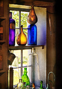 Old Windows Framed Prints - Pharmacy - Colorful glassware  Framed Print by Mike Savad