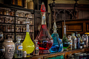 Potions Framed Prints - Pick An Elixir Framed Print by Adrian Evans