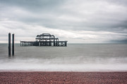 Grey Clouds Prints - Pier Remains in Brighton Print by Semmick Photo