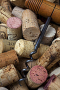 Wine Corks Prints - Pile of wine corks with corkscrew Print by Garry Gay