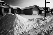 Snow Falling Photos - piles of cleared snow outside upmarket residential street during winter Saskatoon Saskatchewan Canad by Joe Fox