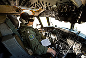 Featured Acrylic Prints - Pilot Sits In The Pilot Seat Of A C-2 Acrylic Print by Stocktrek Images